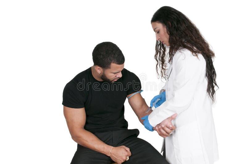 Paciente de examen del doctor fotos de archivo