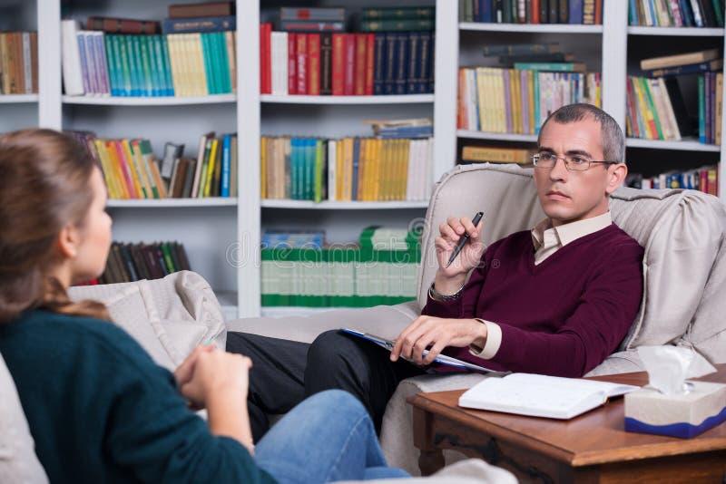 Paciente del psiquiatra y de la mujer imagen de archivo libre de regalías