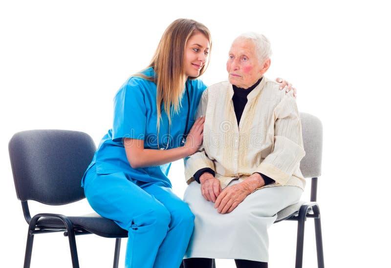 Paciente preocupante que consuela de la enfermera foto de archivo libre de regalías