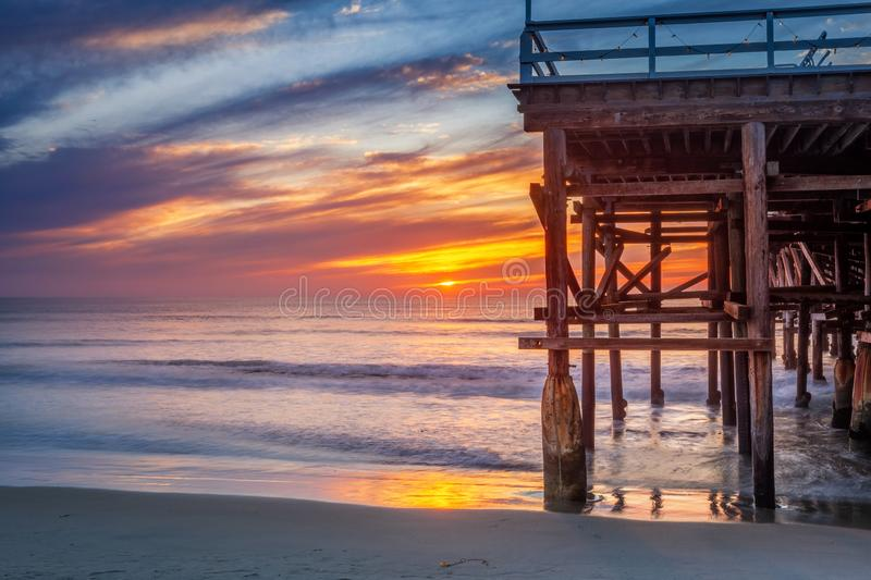 Pacific beach pier at sunset stock photography