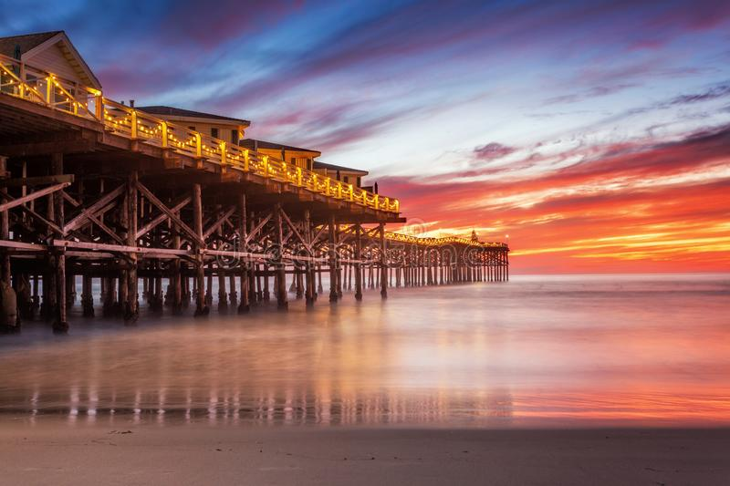 Pacific beach pier at sunset stock image
