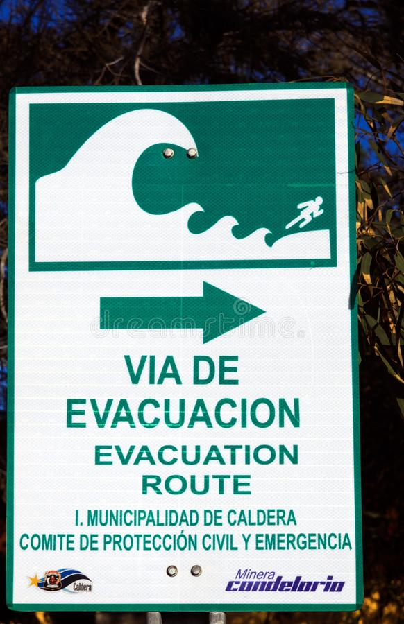 PACIFIC COAST, CHILE - DECEMBER 26. 2011: Close up of sign for evacuation route in case of tsunami Spanish language. Close up of sign for evacuation route in royalty free stock photos