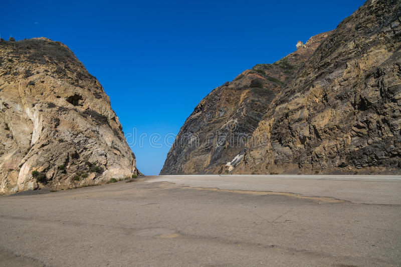 Pacific Coast Highway. The Pacific Coast Highway passes through rock formations on the coast at Point Mugu, California stock photos