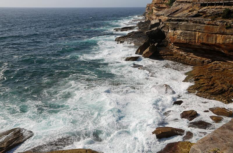 The ocean and the cliff stock photography