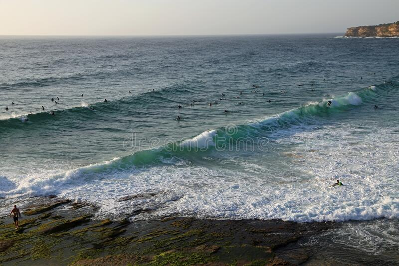 Surfers and the ocean royalty free stock photography
