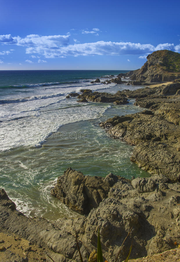Pacific coast surf beach and rocks in Mexico. Surf crashes on the rocks near Cerrito Baja California Sur Mexico stock images