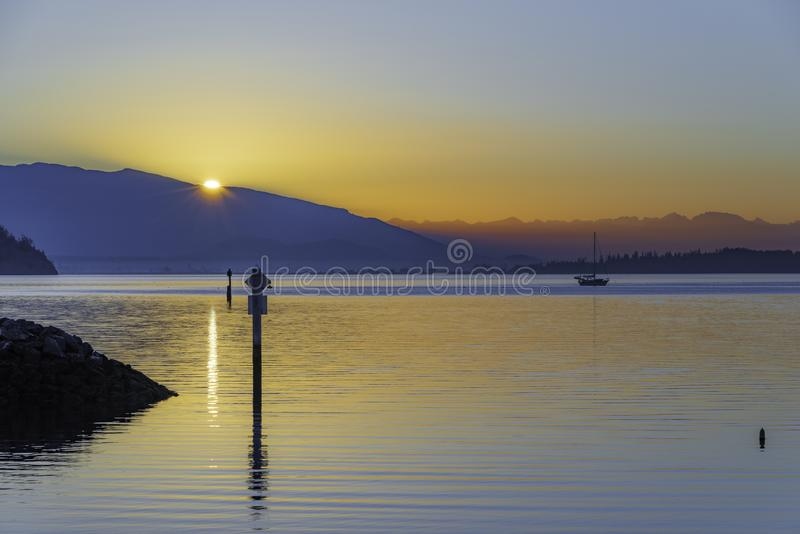 Pacific Northwest Sunrise at anchor royalty free stock photo