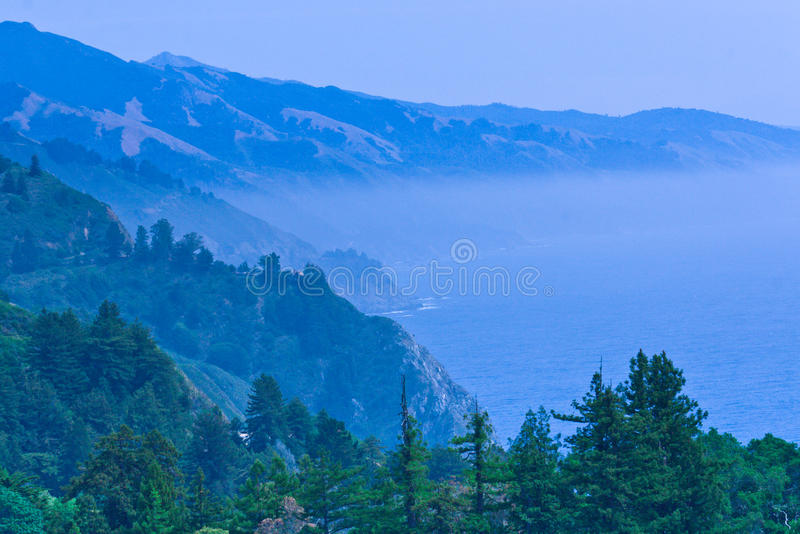 Pacific ocean bay in a blue fog mist. California, USA royalty free stock photos