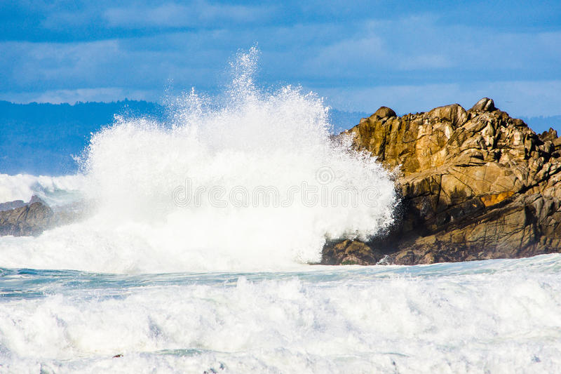 Pacific ocean crashes stock images