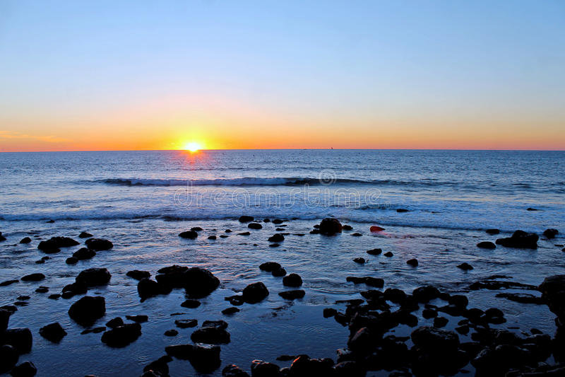 Pacific Ocean Sunset. The sun is setting down into Pacific Ocean stock photography