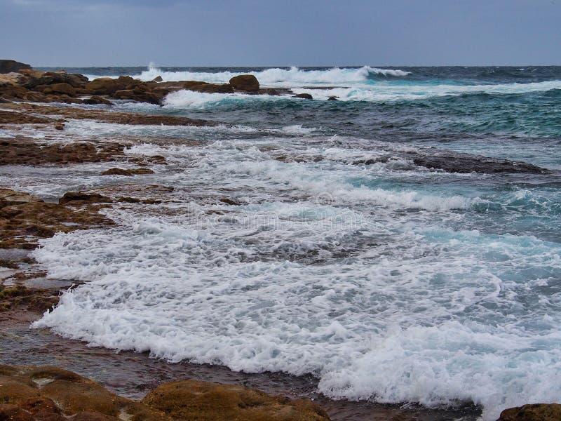 Pacific Ocean Waves on Bondi Rocks, Sydney, Australia stock images