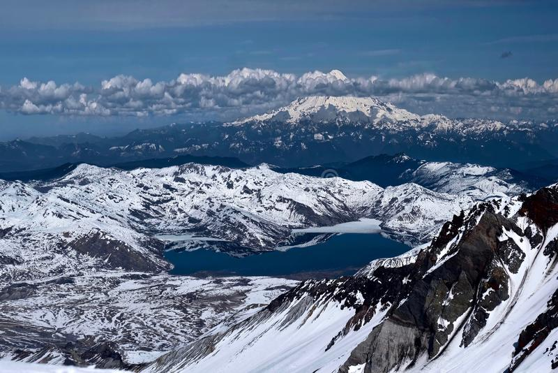 Pacific ring of fire. Spirit Lake and Mount Rainier from Mount Saint Helens summit. royalty free stock photo