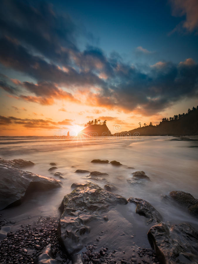 Pacific sunset at Olympic National Park. This is a very wide angle long exposure of pacific sunset with colorful clouds at Olympic National Park stock photo