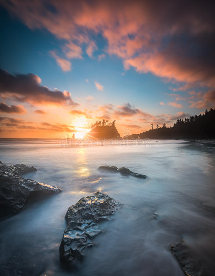 Pacific sunset at Olympic National Park. This is a very wide angle long exposure of pacific sunset with colorful clouds at Olympic National Park royalty free stock image