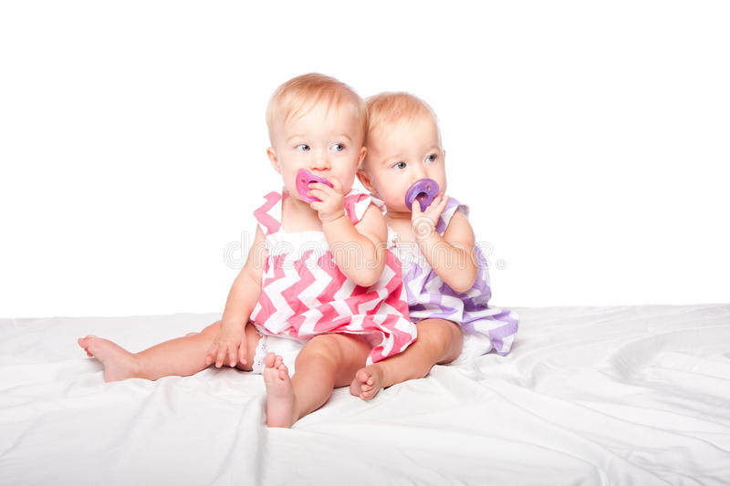 Download Pacifier twins stock photo. Image of pink, love, sisters - 32576146