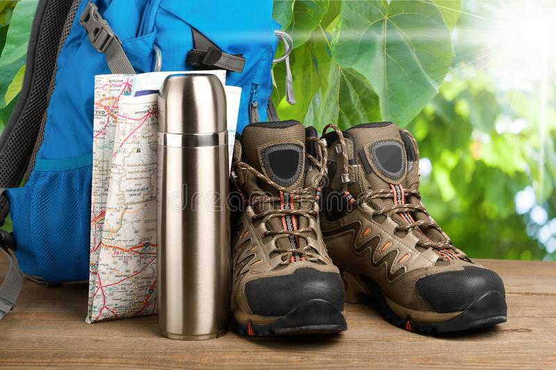 Hiking boots, backpack and map on background. Pack boots hiking map backpack sport activity royalty free stock photography