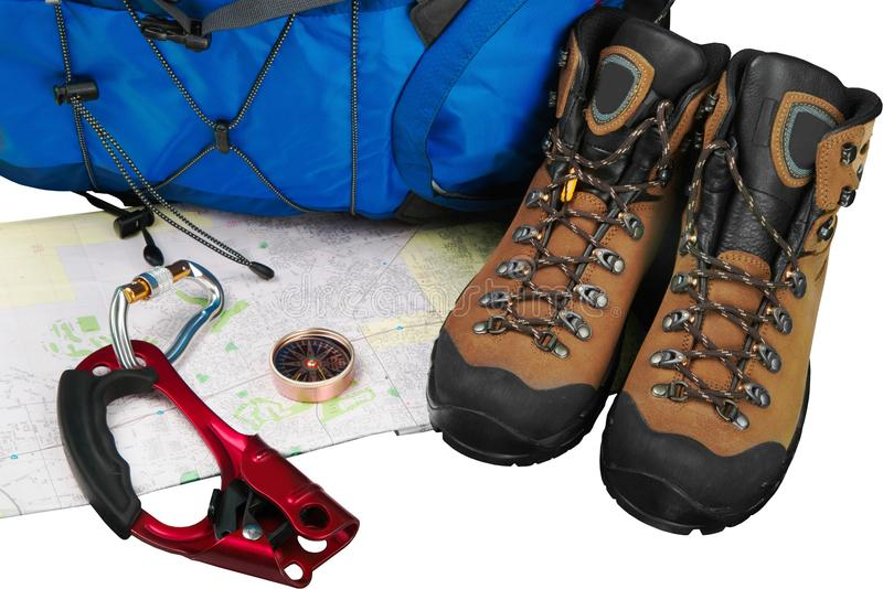 Hiking boots, backpack and map on background. Pack boots hiking map backpack sport activity stock image