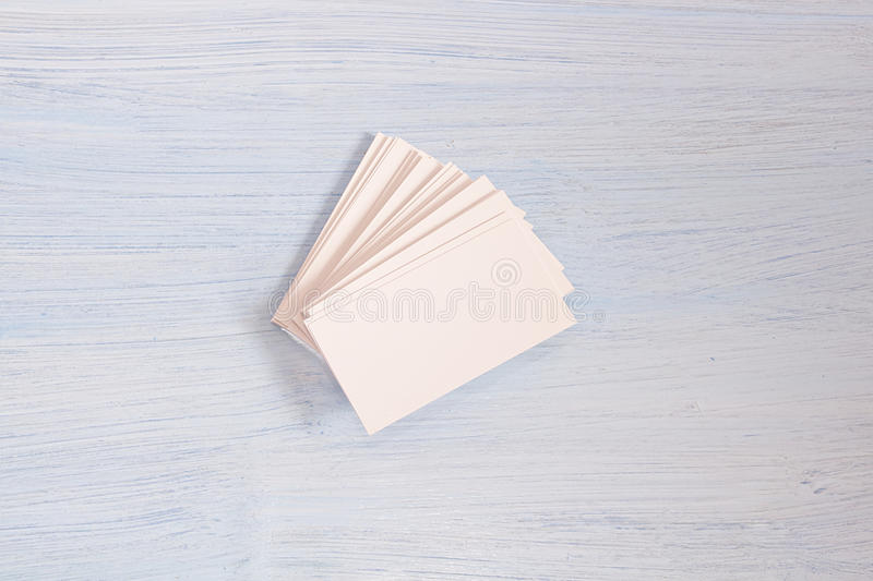 A pack of cards lies on blue background stock photography