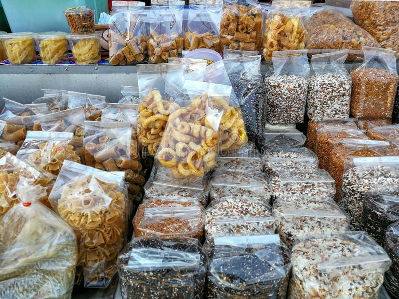 Pack of cereal rice, Kab-Moo or deep fried pork skin, and crisp stock images