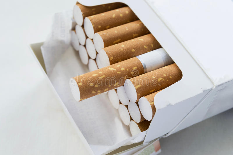 Pack of cigarettes. Opened pack full of cigarettes closeup stock image