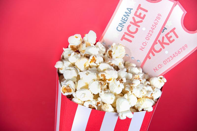 Cinema pop corn and tickets on a red background stock photo