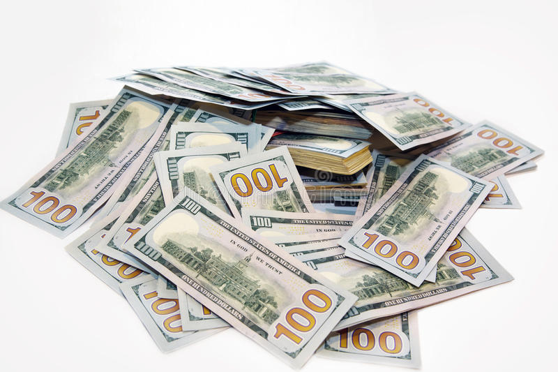 Pack of dollars in a pile of money. On the table close-up stock images