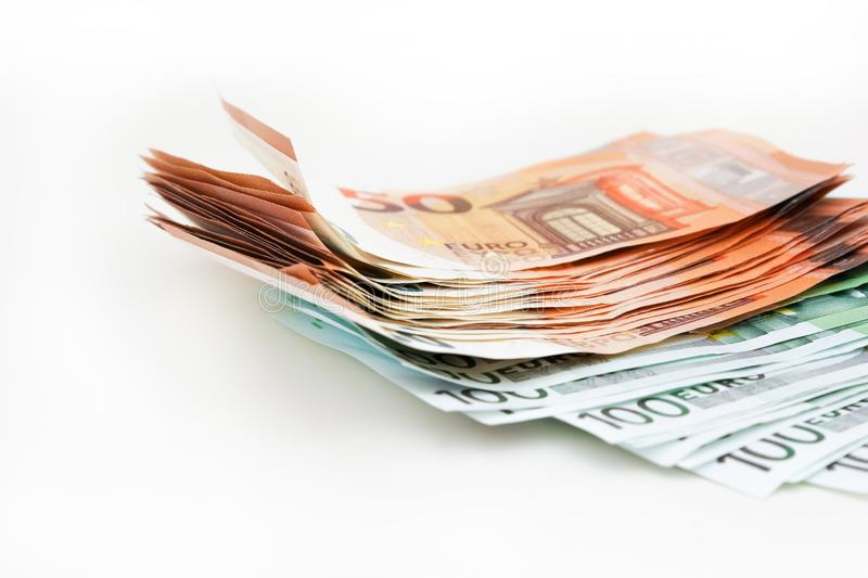 Pack euro money banknotes on white background. Euro cash background. Money savings concept.  royalty free stock photography