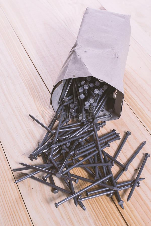 Pack full of nails. On wooden table stock photos