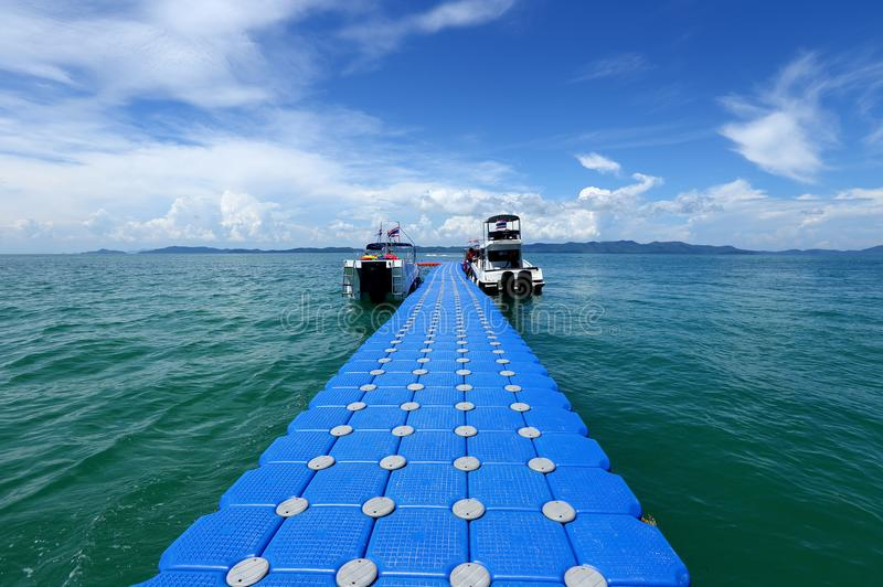 Pack Group of Blue Cubes Float on clear Ocean beautiful beach for tourist to walk from boat royalty free stock photography