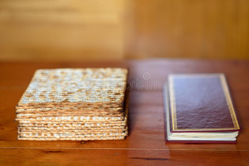 Passover. Traditional seder table set for a Jewish Festive meal matzah and Passover Haggadah. Pack of matzah or matzo or or matza and Passover Haggadah on a royalty free stock images