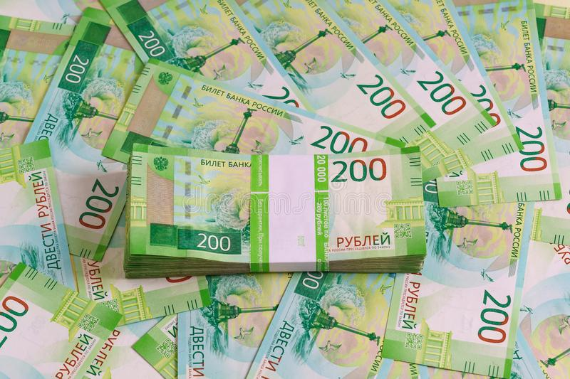 A pack of new Russian two-ruble banknotes in a Bank package. A pack of new Russian two-ruble bills in a Bank package on the background of other bills royalty free stock image