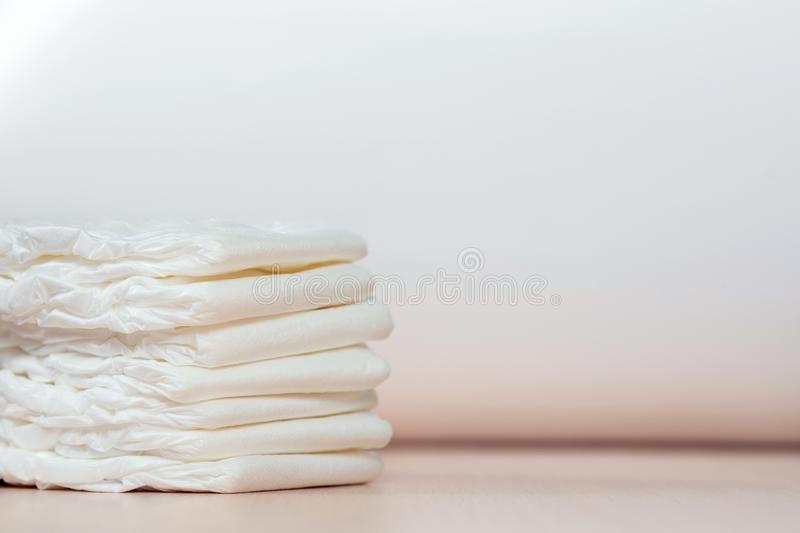 The pack of white children`s diapers lies on a table royalty free stock photo