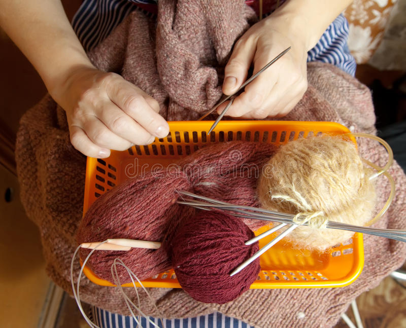 Pack with wool and knitting needle stock photography