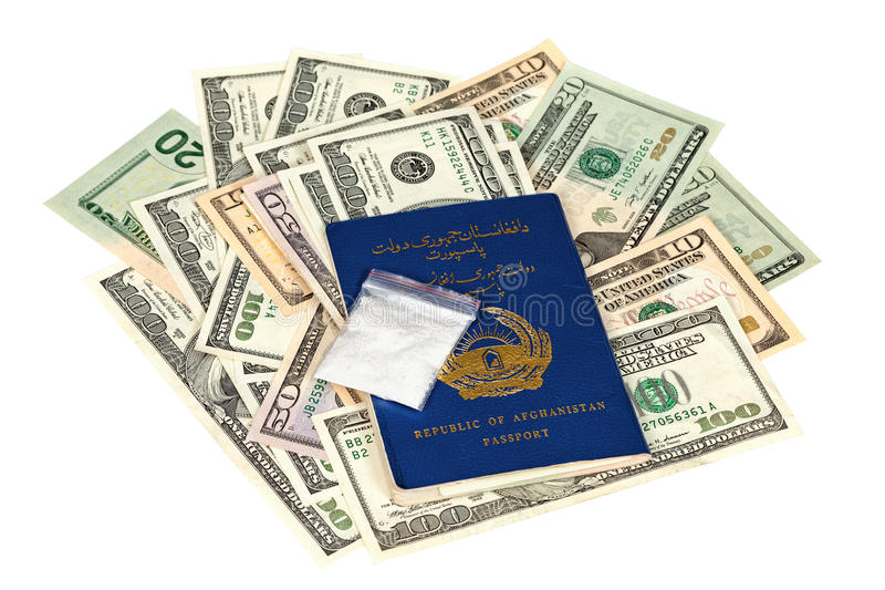 Package with drug over the Afghan passport. And U.S. dollars royalty free stock photo