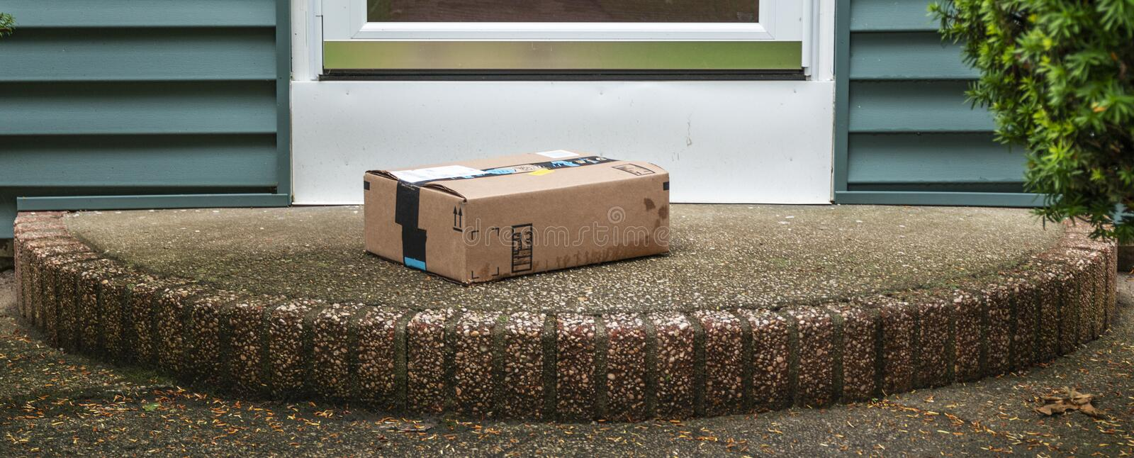 Package left on porch in the rain stock photos