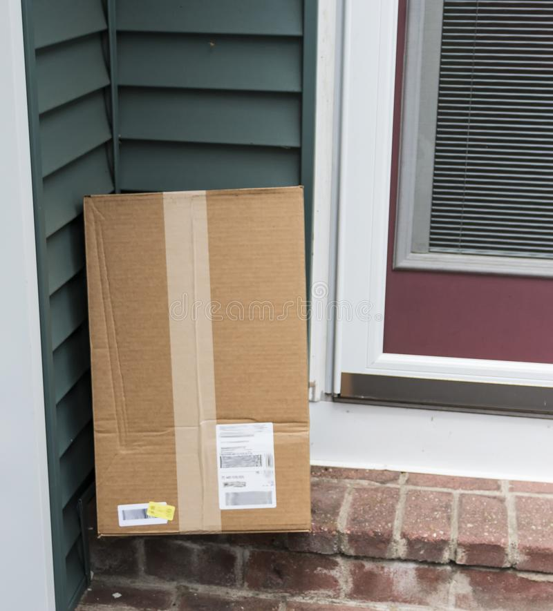 Package delivered to back door of home royalty free stock images