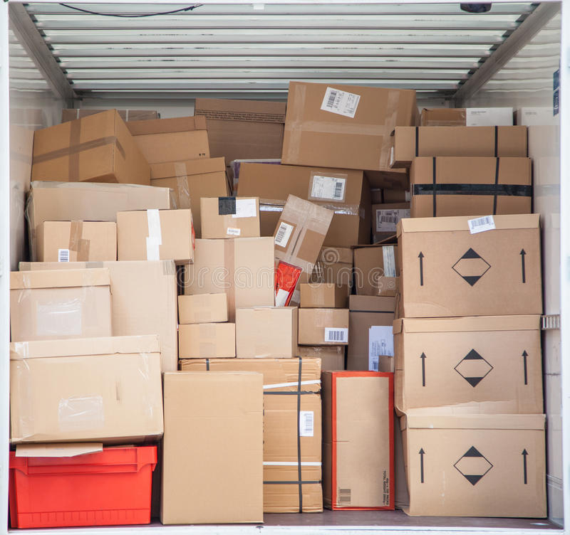 Packages in delivery truck stock photos