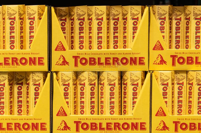 Packages of Toblerone brand chocolate nougat bars for sale. In a supermarket shelf stock image