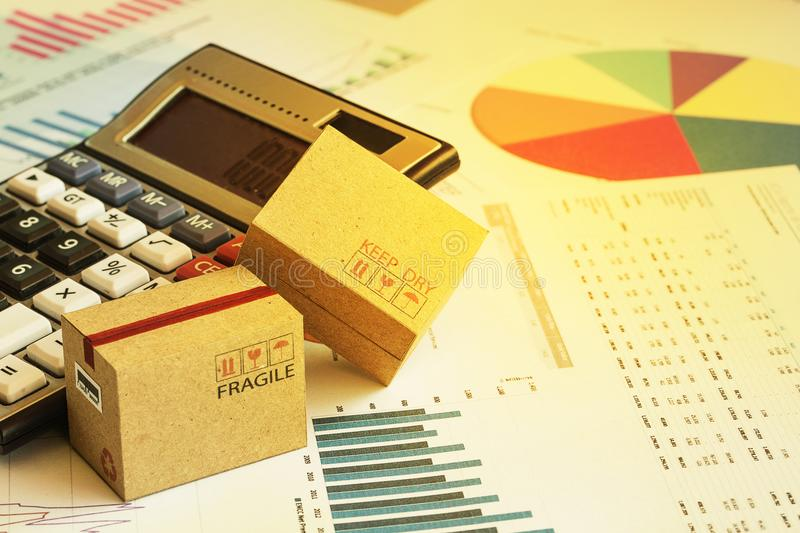 Packaging cardboard boxes with calculator and this type of financial charts include stacks of bar compare between the expansion o royalty free stock image