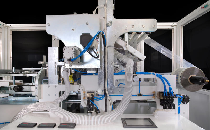 Download Packaging machine stock photo. Image of chain, plastic - 18750226