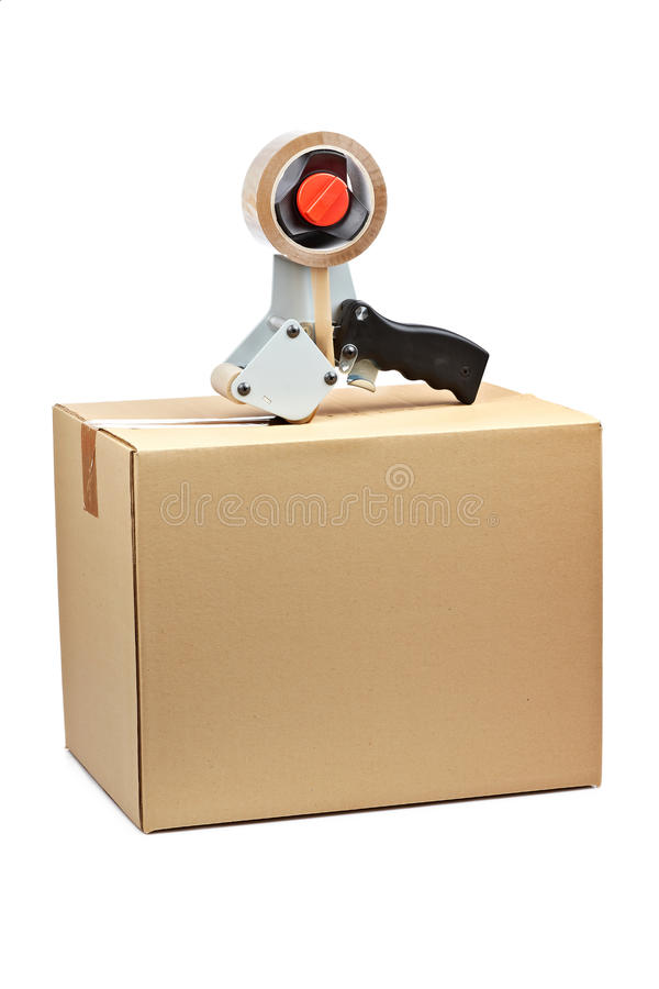 Free Packaging Tape Dispenser And Shipping Box Royalty Free Stock Image - 13939196