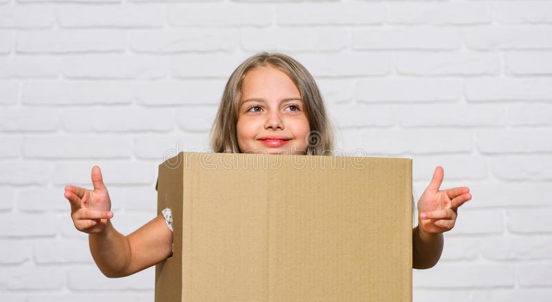 Packaging things. Prepare for moving. Rent house. Real estate. Make moving easier. Girl small child carry cardboard box stock photos