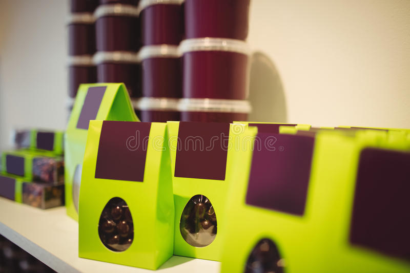Packed chocolates in green box in display. At cake shop royalty free stock images