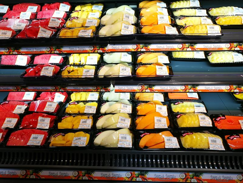 Packed fresh fruit ready to eat, supermarket. A photo showing some freshly packed cut fruit such as pomelo, jackfruit and water melons, on the chilled shelves of stock image