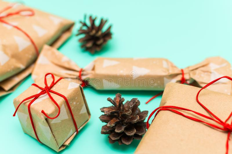 Packed gifts in kraft paper on blue background stock photos