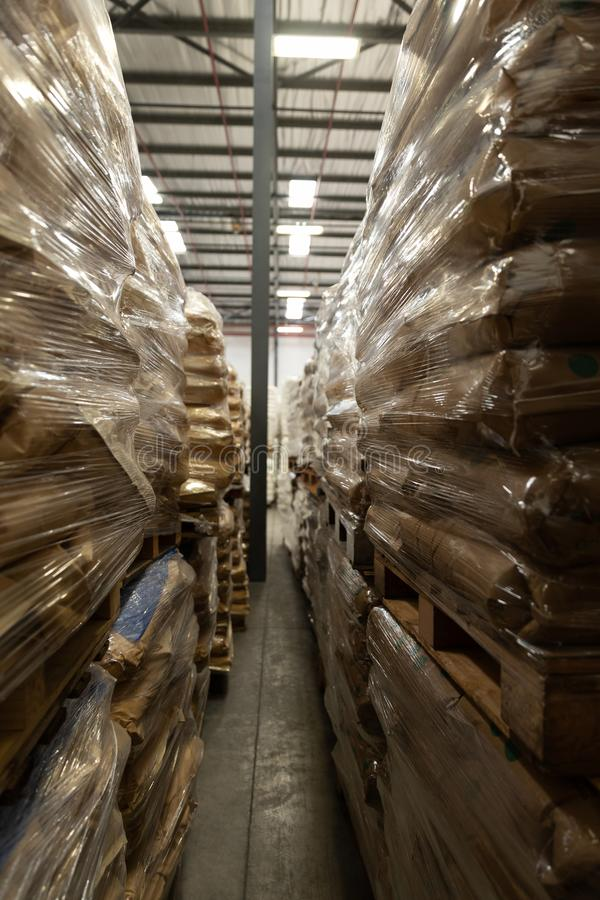 Packed goods on a rack in warehouse. Packed goods arranged on a rack in warehouse. This is a freight transportation and distribution warehouse. Industrial and royalty free stock images