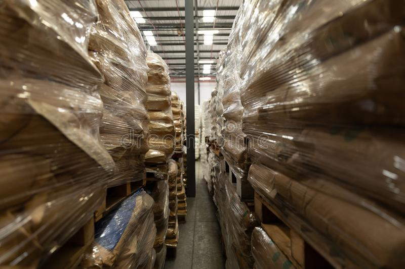 Packed goods on a rack in warehouse. Packed goods arranged on a rack in warehouse. This is a freight transportation and distribution warehouse. Industrial and stock photo