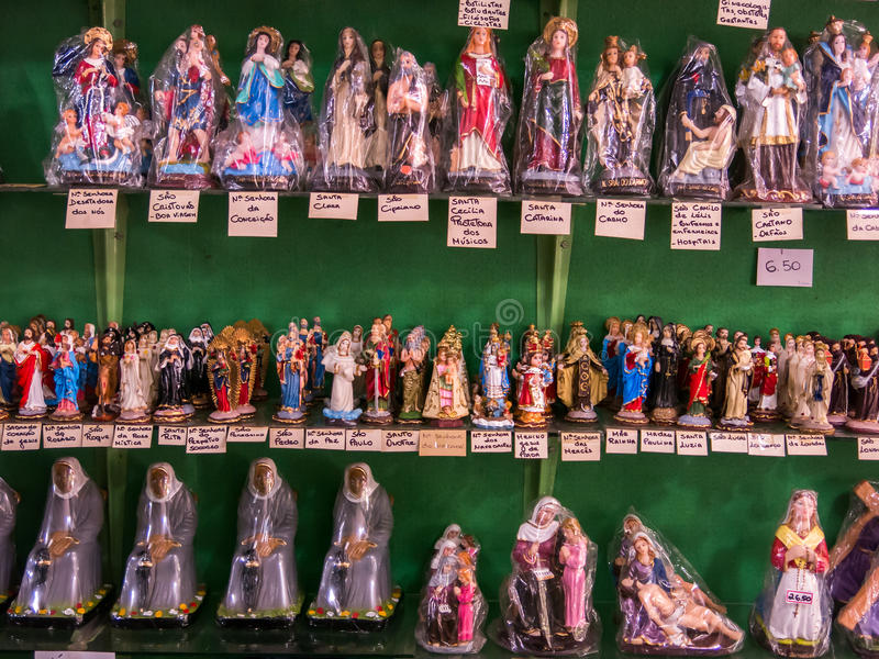 Packed saints statues. In a tradicional brazilian shop stock photo