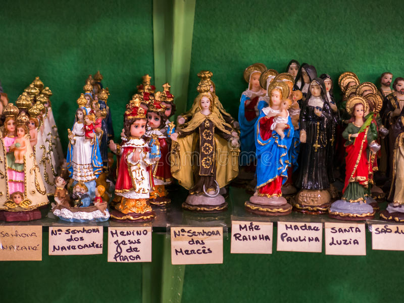 Packed saints statues. In a tradicional brazilian shop stock photography