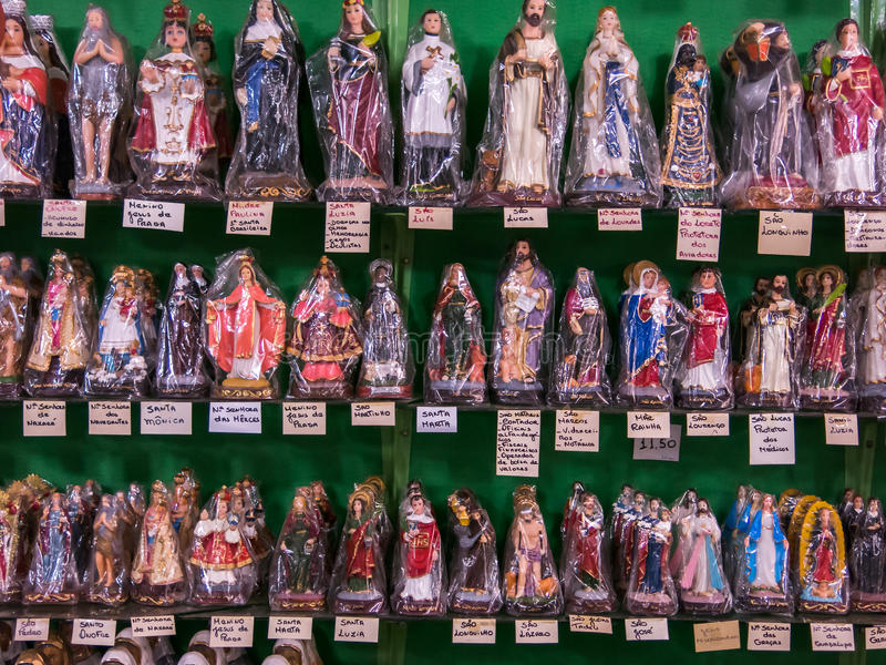 Packed saints statues. In a tradicional brazilian shop stock photos
